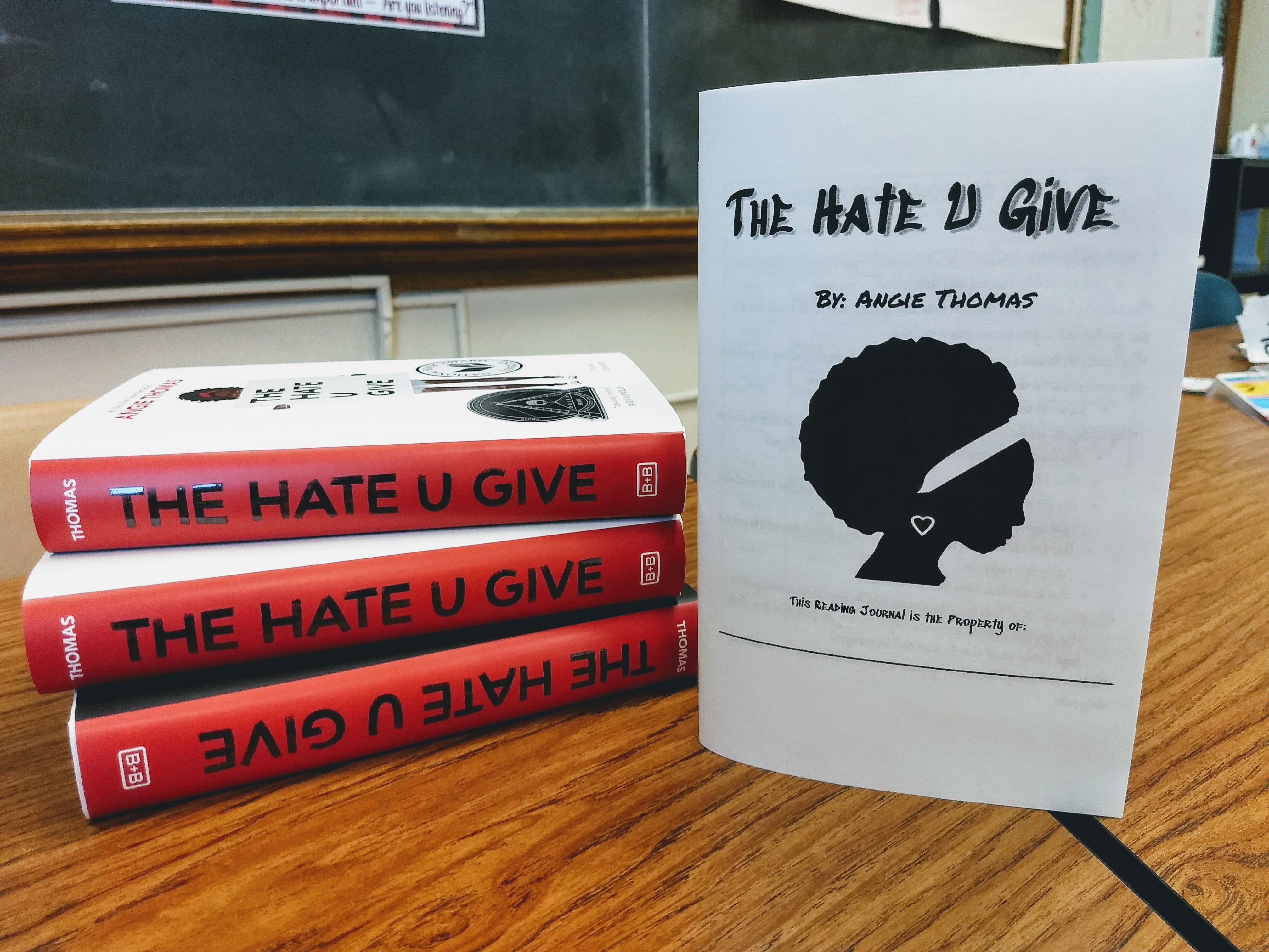 Copy of books of The Hate U Give with a reading journal and workbook for the novel, available on Teachers Pay Teachers